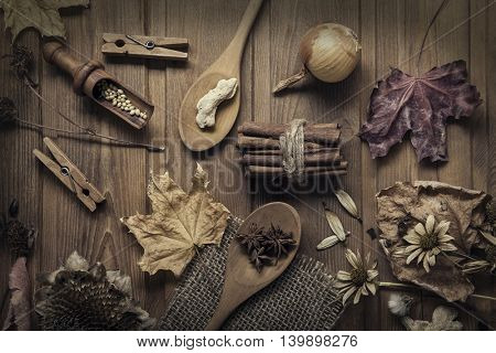 autumn background with fruits and spices with dried flowers place for inscription