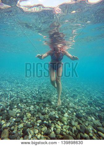 woman swimming in a sea