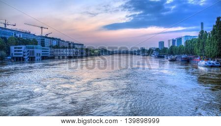 Paris, France - June 5 2016: Paris cityscape with the River Seine at dusk during the massive flooding in Paris in the first days of June 2016.