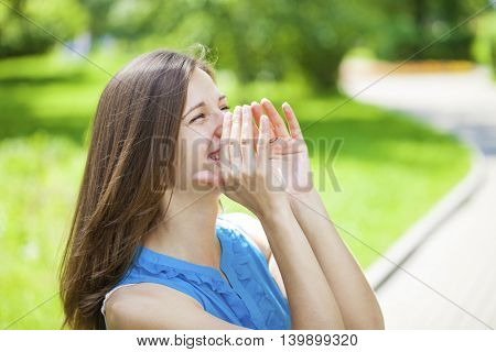 Screaming brunette woman, summer street outdoors