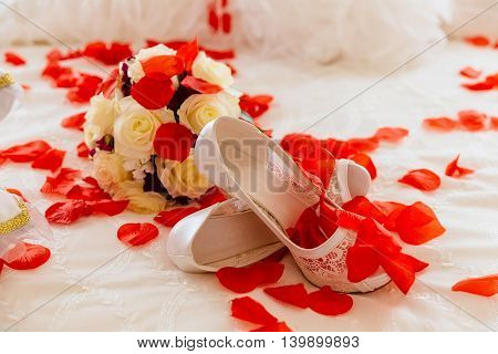 wedding shoes and wedding bouquet of roses