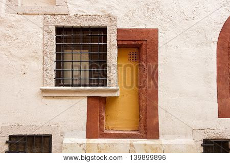 Abstract shot of the bricked up doorway and window with bars