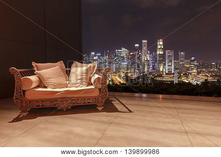 Shot of a bench on a balcony with views over the city of Singapore
