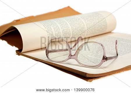 Old vintage magazine and glasses isolated on white background with clipping path