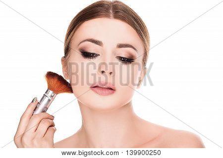 Beauty Portrait Of Woman Doing Makeup.