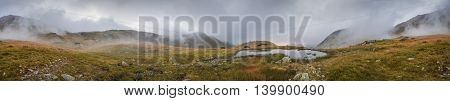 Wide Panoramic View of Small Tarn with Fog in West Tatra Mountains at Sunset
