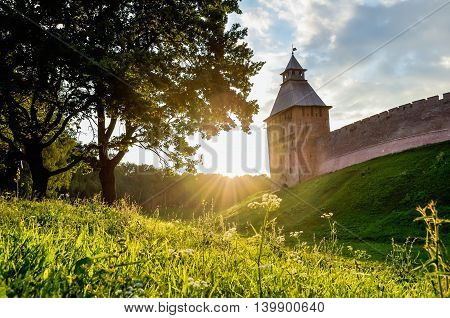 Architecture landscape in sunny summer evening - Saviour tower of Veliky Novgorod Kremlin Russia. Architecture sunset summer view of architecture landmark in the back light