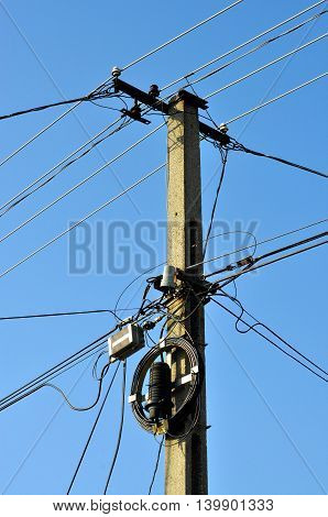 LED street lighting and power lines with blue sky background