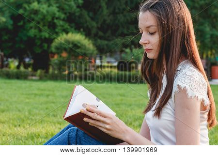 Beautiful Young Woman with Note at Outdoor. Education Concept