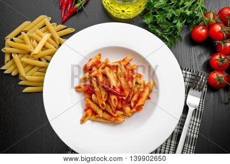 penne with arrabbiata sauce and fresh ingredients
