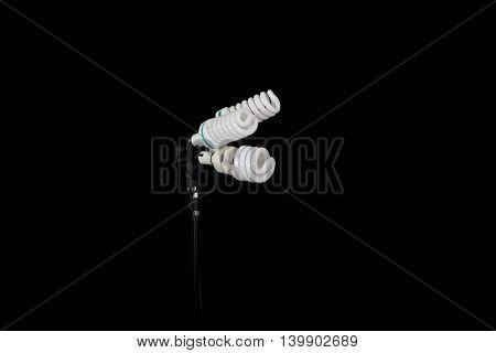 economic light bulb isolated on black background