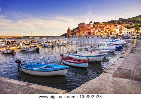 Elba island Rio Marina village bay. Marina boats and lighthouse. Tuscany Italy Europe.