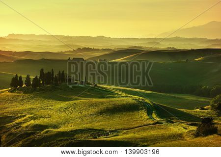 Tuscany spring rolling hills on sunset. Rural landscape. Green fields and farmlands. Volterra Italy Europe