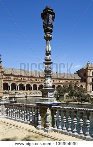 Detail of the ceramic tiled balustrade and lamp pole at the Plaza de Espana (Spain Square) in Seville Spain