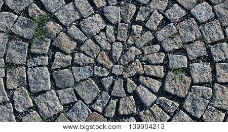 Granite paving in the shape round in Prague