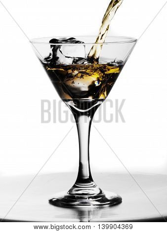 Alcoholic drink with splash in the ices o white background
