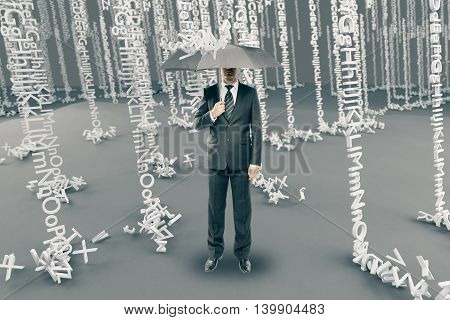 Businessman with umbrella in abstract alphabet rain