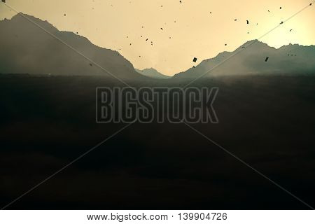 Abstract backlit paper mountains on sunset background. 3D Rendering