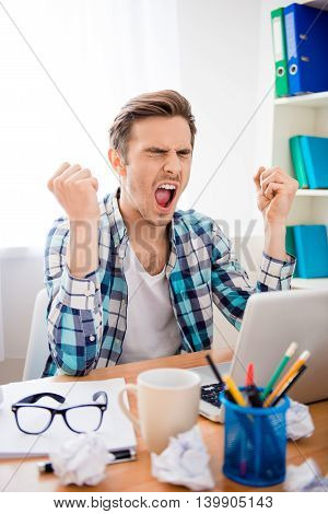 Frustrated Young Tired Man Working With Laptop And Screaming