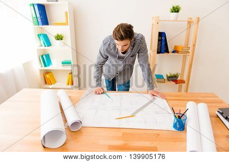 Young Architect Sketching A Construction Project On His Plane