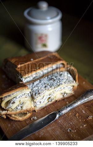 Cheesy spinach quiche on a wooden Board