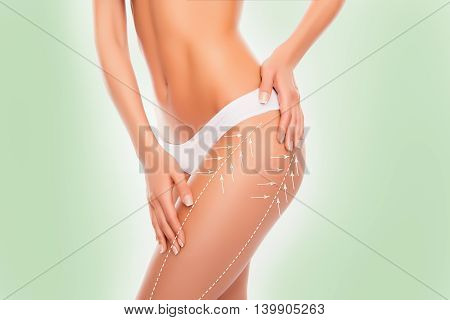 Beautiful Slim Fit Woman Touching Her Body With Arrows Isolated On Green Background