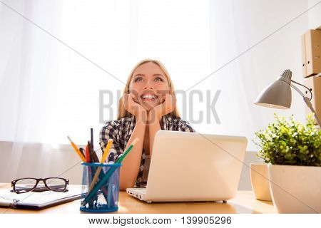 Pretty Cheerful Successful Young Woman Dreaming In Office