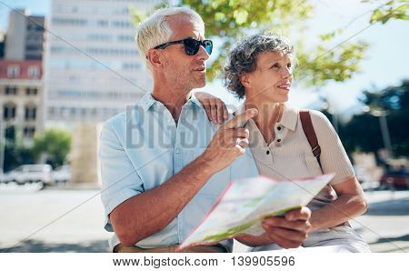 Tourist Using City Map For Directions