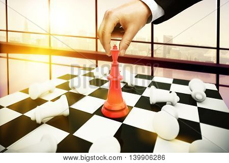 Businessman playing chess on city view background. Strategic planning concept