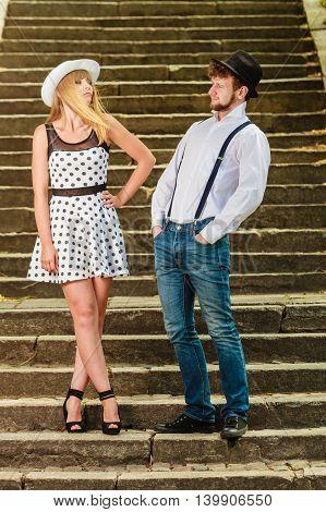 Loving Couple Retro Style Flirting On Stairs