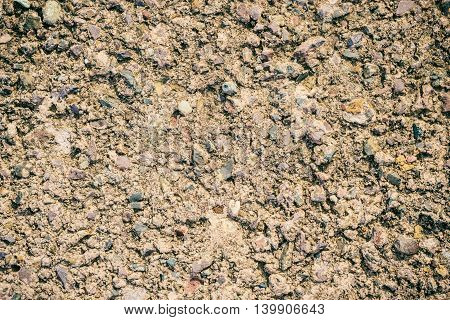Brown grunge wall stone background or texture solid rock