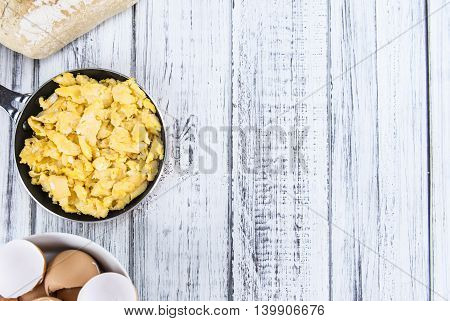 Scrambled Eggs (selective Focus) On Wooden Background
