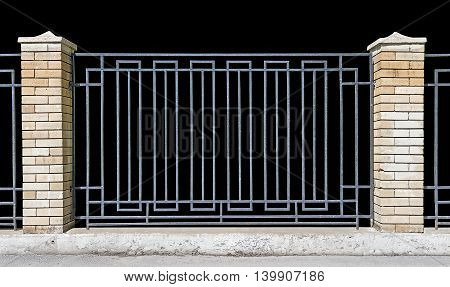 metal fence with brick pillars Black background