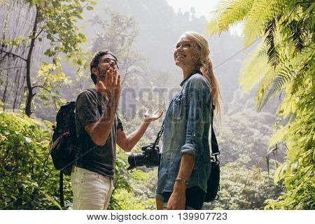 Tourist Couple Enjoying The Rain In Forest