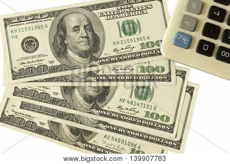 White background with money American dollar bills with calculator