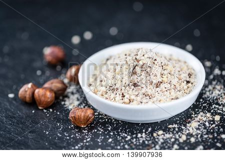Grounded Hazelnuts On A Slate Slab