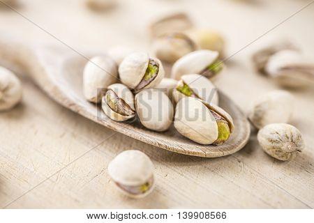 Whole Pistachios On Wood