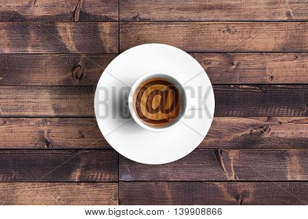 top of view of great italian espresso coffee in a white cup with et @ email symbol shape technology concept