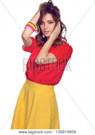 Beautiful woman with curly hair wearing a red jacket, isolated on white background