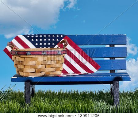 Blue park bench with handmade basket and flag.