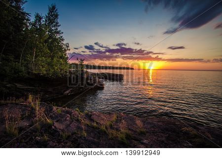 Sunset On The Shores Of Lake Superior.  Sunset on the shores of Lake Superior outside of L'Anse Michigan at the Point Abbaye Nature Sanctuary.