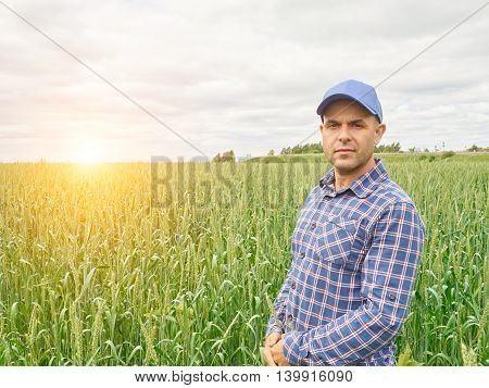 Farmer In Plaid Shirt Controlled His Field.