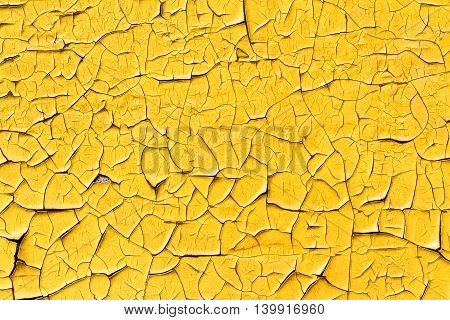Wall Surface With Yellow Old Cracked Paint