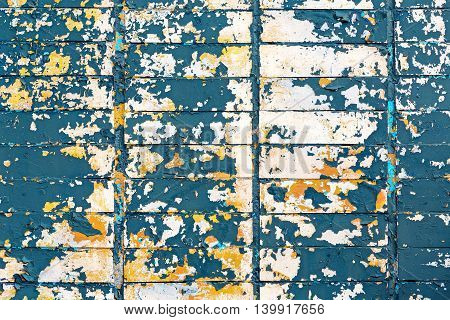 Colorful Peeling Paint On Tiled Wall Background