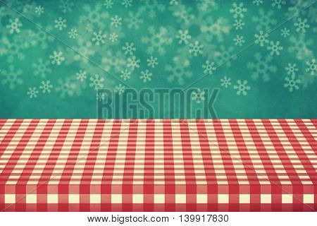 Christmas holiday background with empty table covered with checked tablecloth. Ready for product montage display