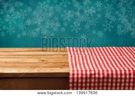 Christmas holiday background with empty wooden table and checked tablecloth. Ready for product montage display