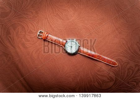 Men's Wristwatches On Brown Background.