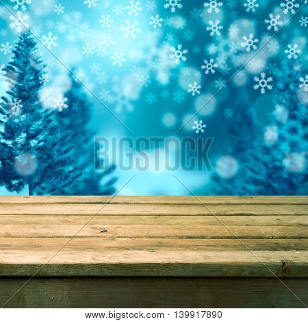 Winter background with empty wooden table. Ready for product montage display