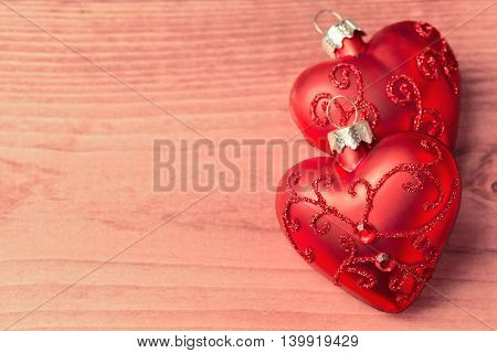 Christmas wooden background with heart shape ornament