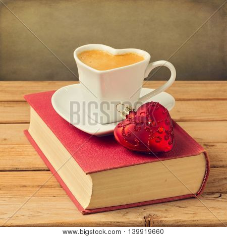 Cup of coffee with Christmas decoration. Heart shape heart and ornament